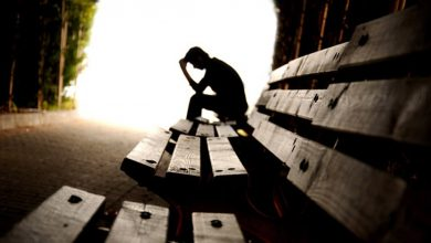 man with depression sitting on bench