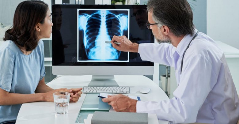 doctor showing patient x-ray