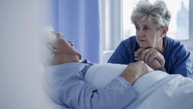 woman in hospital visiting husband