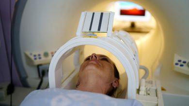 Woman receiving MRI scan.